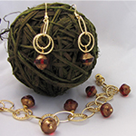 golden rings bracelet and earring set